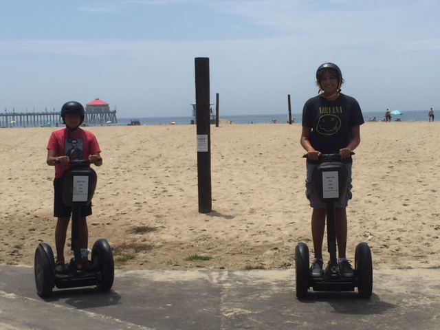 "Our Surf City kids channeling their inner ""Mall Cop"" on Segways from Surf City Segway."