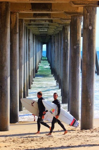 Surfers Under the Pier