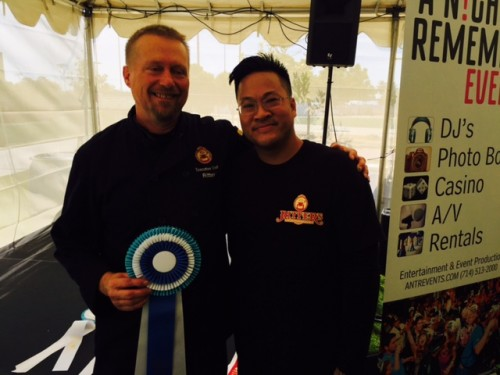 Chef Ritter and Dan from Ritter's Steam Kitchen in Downtown Huntington Beach accept their 1st prize ribbon in the Entrée category of the 2015 Taste of Huntington Beach.