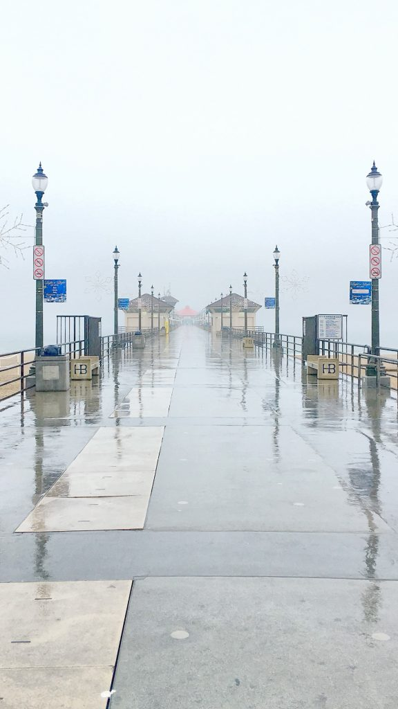 Rainy Huntington Beach Pier by Larry Tenney