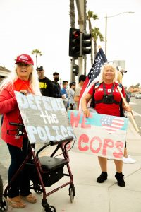 Two women holding signs
