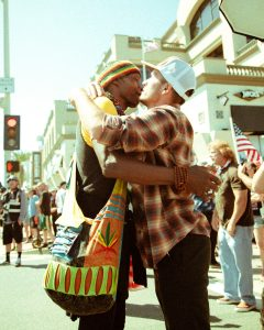 Two men hug it out at protest rally